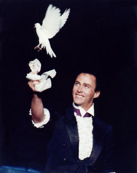 Lance Burton Master Magician produces a dove