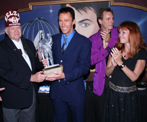 Lance Burton accepts an honorary award from Zelzah Shrine
