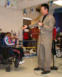 Lance Burton performing for the students at the John F. Miller School